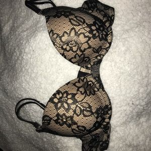 Nude and black lace bra